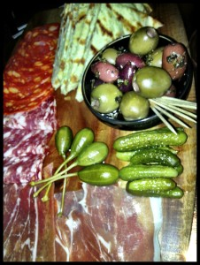 the platter of cold meats, olives and pitta