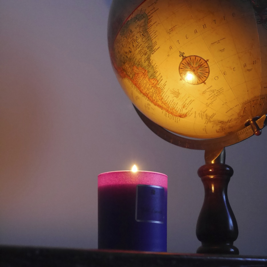 the candle glowing next to our globe