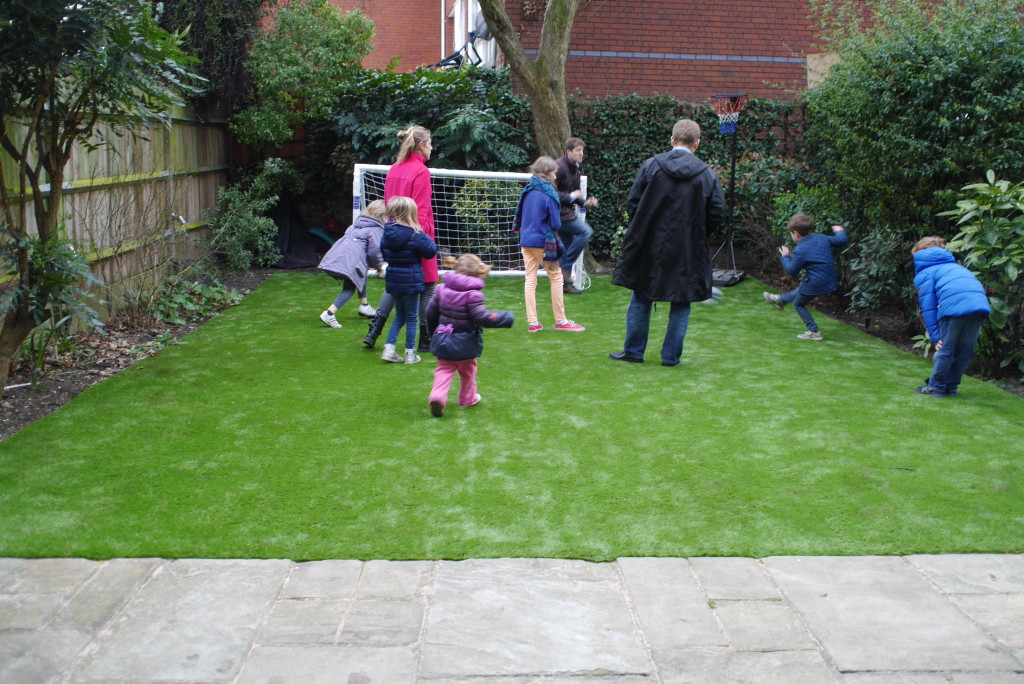 Small scores a goal in a family game on the new grass