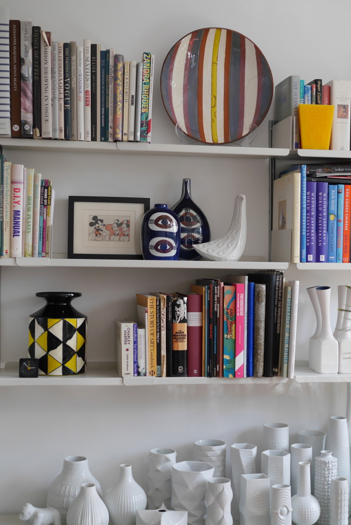 Eddie's colourful bookshelves with plenty of ceramics