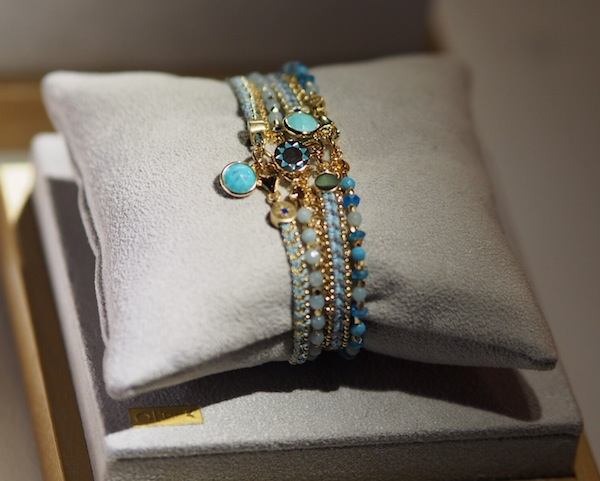 spot the #theirworld bracelet in this stack